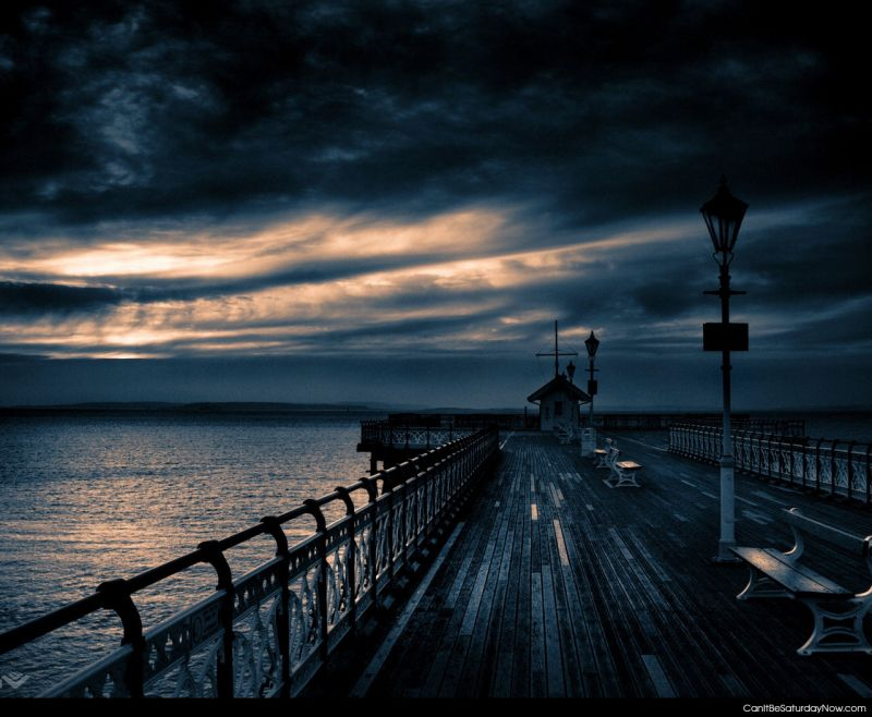 Dark pier sunset